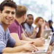 Class Of University Students Using Laptops In Lecture — Stock Photo #48460895