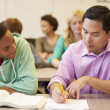 High School Teacher Helping Student — Stock Photo #48461043