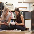 Two Businesswomen Sit On Office Floor With Digital Tablet — Stock Photo #48461055