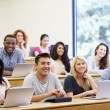 Students Using Laptops And Digital Tablets In Lecture — Stock Photo #48461271