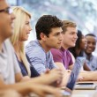 Class Of University Students Using Laptops In Lecture — Stock Photo #48461417