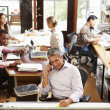 Interior Of Busy Architect's Office With Staff Working — Stock Photo #48461447