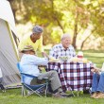 Two Senior Couples Enjoying Camping Holiday — Stock Photo #48461957