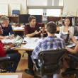 Group Of Architects Meeting Around Desk — Stock Photo #48461963