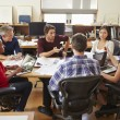 Group Of Architects Meeting Around Desk — Foto de Stock   #48461963