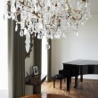 Room In Modern House With Chandelier And Grand Piano — Stock Photo #48461979