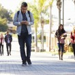 Students Walking Outdoors On University Campus — Stock Photo #48462029