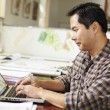 Male Architect Working At Desk On Laptop — Stock Photo #48462113