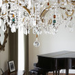 Room In Modern House With Chandelier And Grand Piano — Stock Photo #48462223