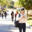 Students Walking Outdoors On University Campus — Stock Photo #48462629
