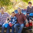 Fathers With Sons Unpacking Truck — Stock Photo #48462681