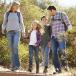 Family Hiking In Countryside Wearing Backpacks — Stock Photo #48462759