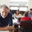 Portrait Of Male Architect With Meeting In Background — Stock Photo #48462835