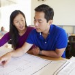 Architects Studying Plans In Modern Office Together — Stock Photo #48462853