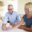 Architects Studying Plans In Modern Office Together — Stock Photo #48462881