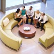 Group Of Businesspeople Having Meeting In Office Lobby — Stock Photo #48462903