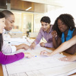 Group Of Architects Discussing Plans In Modern Office — Stock Photo #48463045