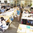 Interior Of Busy Modern Open Plan Office — Stock Photo #48463149