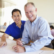 Architects Studying Plans In Modern Office Together — Stock Photo #48463273
