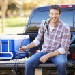 Man Sitting In Pick Up Truck On Camping Holiday — Stock Photo #48463329