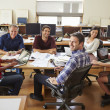 Group Of Architects Meeting Around Desk — Foto de Stock   #48463763
