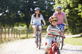 Asian Family On Cycle Ride — Stok fotoğraf
