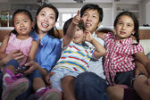 Asian Family Watching TV Together — Stock Photo