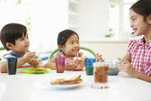 Three Asian Children Having Breakfast — Φωτογραφία Αρχείου