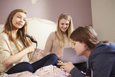 Teenage Girls Relaxing In Bedroom — Stock Photo