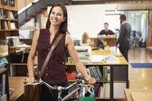 Architect Arrives At Work On Bike Pushing It Through Office — Zdjęcie stockowe