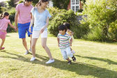 Asian Family Playing In Summer Garden — Stock Photo