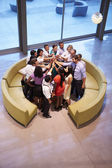 Businesspeople Giving Each Other High Five In Office Lobby — Stockfoto