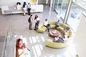 Reception Area Of Modern Office Building With People — Foto Stock