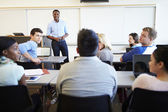Male Tutor Teaching University Students In Classroom — Stock Photo
