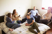 Teenagers Relaxing In Bedroom — Stock Photo