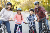 Portrait Of Hispanic Family On Cycle Ride In Countryside — Stock Photo