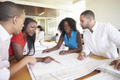 Group Of Architects Discussing Plans In Modern Office — Stock Photo