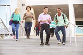 High School Pupils And Teacher On Steps — Stock Photo