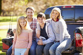 Family Sitting In Pick Up Truck On Camping Holiday — Stockfoto