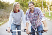Couple On Cycle Ride In Countryside — Stock Photo
