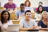Students Using Laptops And Digital Tablets In Lecture — Stock Photo