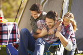 Father And Children Enjoying Camping Holiday In Countryside — Stock Photo