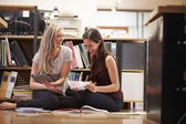Two Businesswomen Sit On Office Floor With Digital Tablet — Stock Photo
