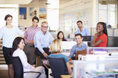 Businesspeople Having Meeting In Modern Open Plan Office — Stock Photo