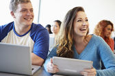 University Students Using Digital Tablet And Laptop In Class — Stock Photo