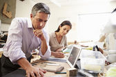 Two Architects Making Models In Office Using Digital Tablet — Stock Photo