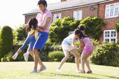 Asian Family Playing In Summer Garden — Stockfoto