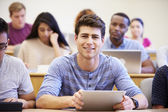 Male University Student Using Digital Tablet In Lecture — Stock Photo