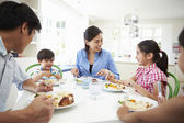 Asian Family Eating Meal Together — Stock Photo
