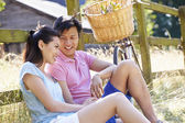 Asian Couple Resting By Fence — Foto Stock